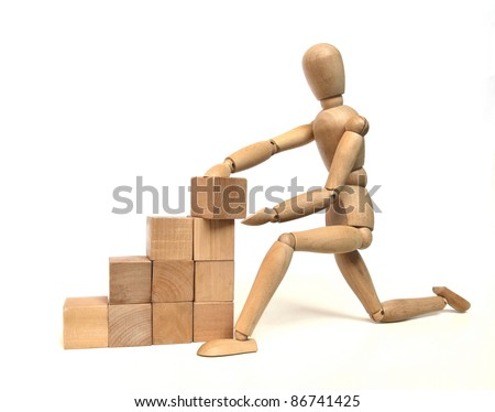 Wooden craftsman puts last block on a natural colored stairs - stock photo