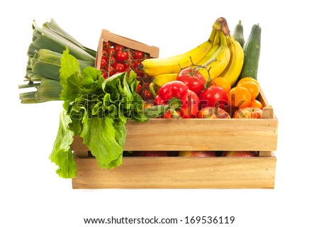 Wooden crate fresh vegetables and fruit isolated over white background - stock photo