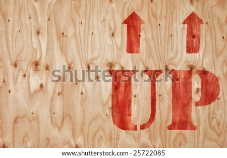 """wooden crate with an arrow-sign """"up"""" - stock photo"""