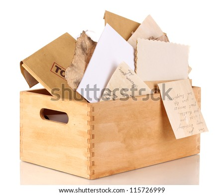 Wooden crate with papers and letters isolated on white - stock photo
