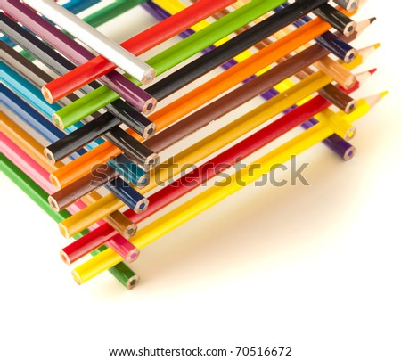 wooden crayons tower on a white background - stock photo
