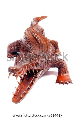 Wooden crocodile. Isolated on white. - stock photo