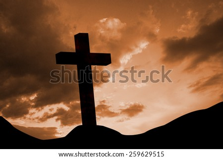 Wooden cross against cloudy sky