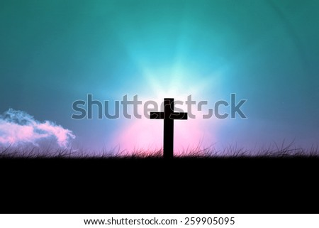 Wooden cross against magical sky