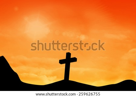 Wooden cross against sky and mountain