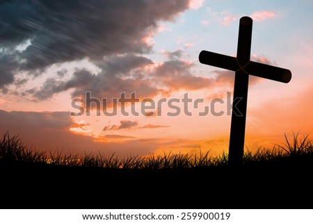 Wooden cross against sun set