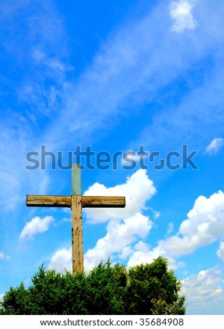 Wooden cross and blue sky - stock photo