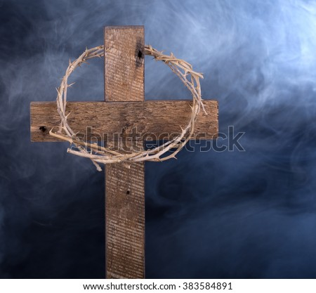 Wooden cross and crown of thorns on an abstract background