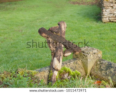 Wooden Cross in the Churchyard in the Cotswold Village of Barnsley in Rural Gloucestershire, England, UK
