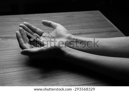 Wooden cross in the hands - stock photo