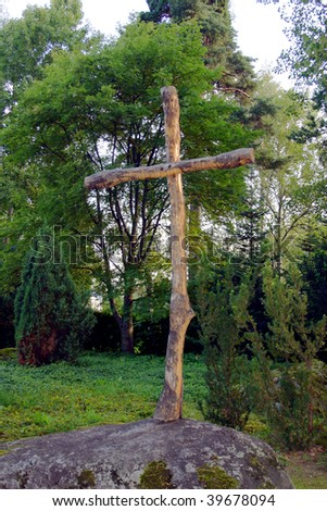 Wooden cross on anonymous grave
