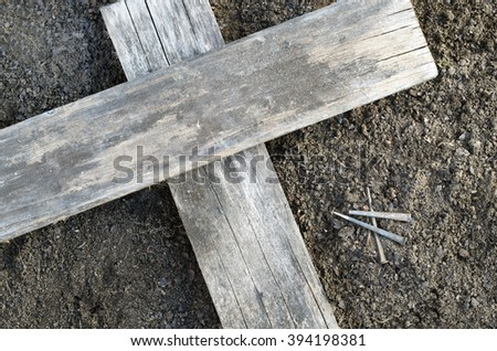Wooden Cross on Earth With Three Nails