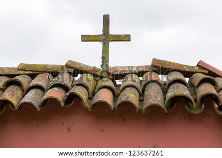 Wooden cross on gate at Mission La Purisima Conception in California State Park in Lompoc