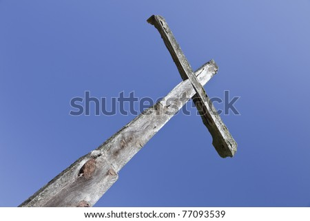 wooden cross on the sky