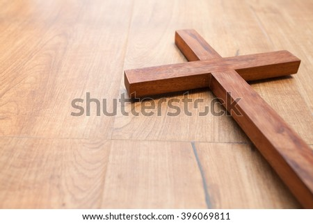 wooden cross on the wooden background. - stock photo
