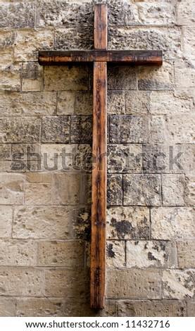 Wooden Cross on Wall - stock photo
