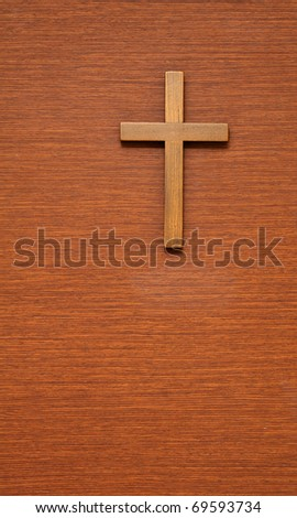 wooden cross on wooden background - stock photo