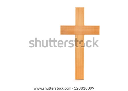 Wooden cross with grain standing on a white background.