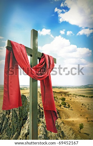 Wooden Cross with Red Cloth - stock photo