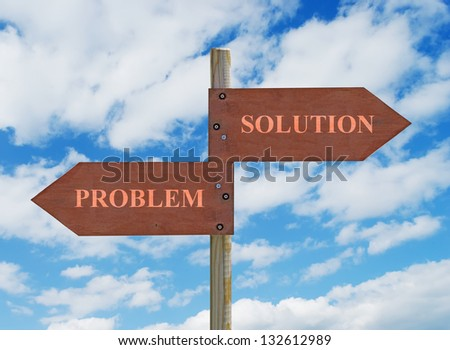 wooden crossroad sign on cloudy background with Problem and Solution writing - stock photo