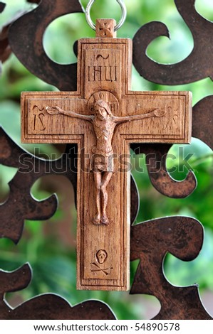 Wooden crucifix and rusty metal pattern background. - stock photo