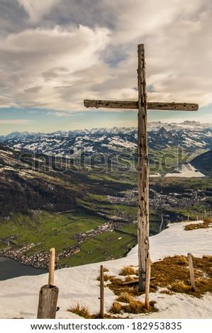 Wooden Crucifix erected at the top of Mt Rigi, Switzerland - stock photo