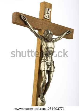 Wooden crucifix with effigy of Christ, closeup, vertical format  - stock photo