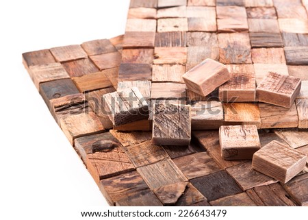 Wooden cubes cut from planks of old boats on a white background - stock photo