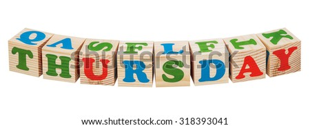 Wooden cubes. Days of the week. Thursday word isolated on a white background