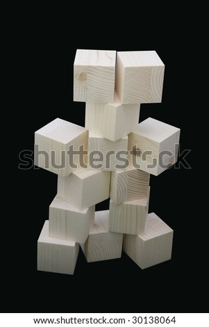 Wooden cubes isolated on black background - stock photo
