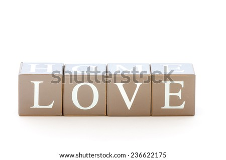 Wooden cubes wit the word love spelled isolated on a white background