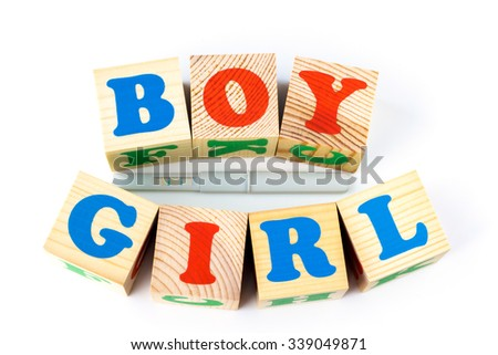 Wooden cubes with inscription Boy Girl on a white background