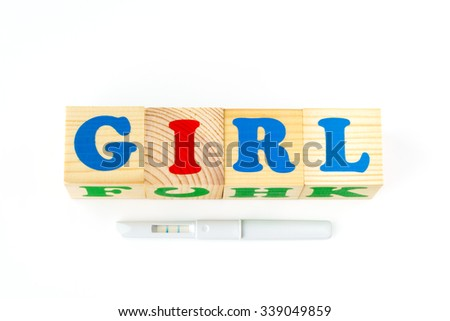Wooden cubes with inscription Girl on a white background