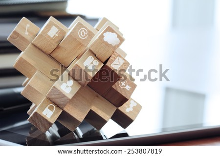 wooden cubes with technology icons on computer as cloud network concept - stock photo