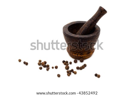Wooden culinary mortar with black pepper on white background