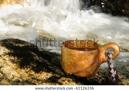 wooden cup, used by hunters and other nature enthusiasts. - stock photo