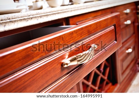 wooden cupboard with opened empty drawer  - stock photo