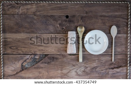 Wooden cutlery on a wooden table - stock photo
