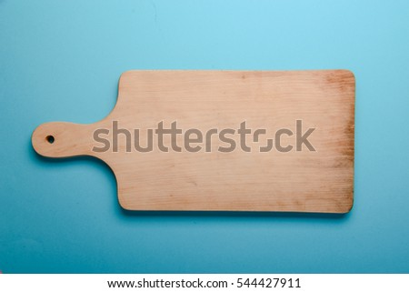 wooden cutting board on a blue background