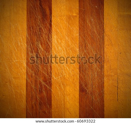 Wooden cutting board with knife marks - stock photo