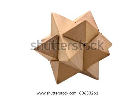 Wooden 3D puzzle on white - stock photo