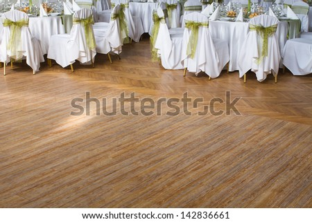 wooden dance floor, wedding or another catered event place - stock photo