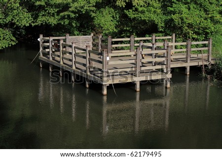 wooden deck in the lake - stock photo