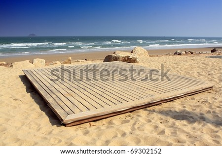 wooden deck on the beach - stock photo