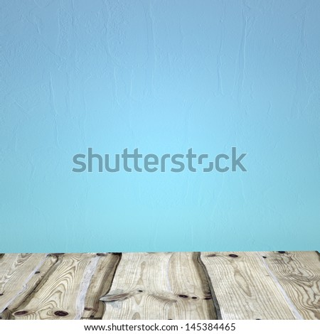 Wooden deck table on green grunge background - stock photo