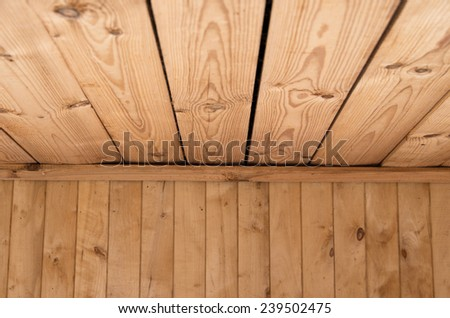 Wooden deck table on old grunge background - stock photo