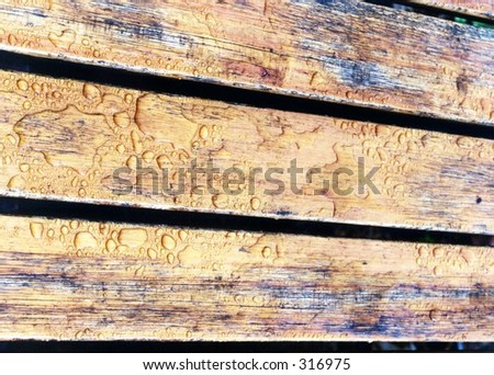 Wooden Deck with rain drops - stock photo