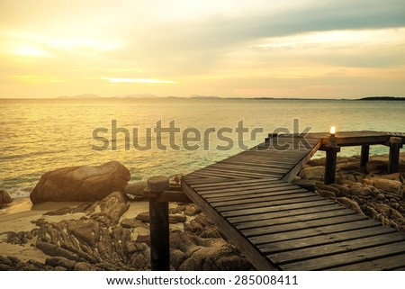 Wooden deck, wooden bridge ,with sunset ,Tropical beach in Munnork island, Rayong, Thailand - stock photo