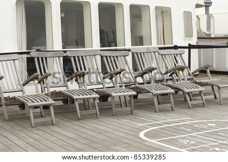 Wooden deckchairs on a ship - stock photo