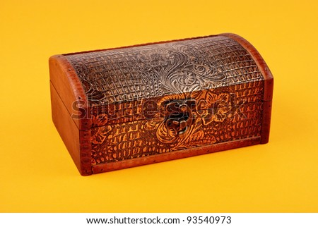 wooden decorative casket on yellow background - stock photo